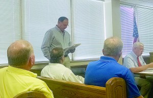 Becky Crissman/Cordele Dispatch Mark O'Donnell, director of business development for AGRI-AFC addresses county commissioners and citizens during a public hearing Tuesday.