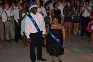 Raven and Homecoming King Dee Dee Troup enter dance together Saturday night.