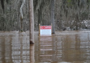 Becky Crissman/Cordele Dispatch Photo taken at the Power Dam in Warwick. A place known for camping a sign is almost completely submersed in water.