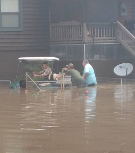 This photo was taken from the facebook page of Carrie White Lang and shows residents in an evacuated area assisted a fellow resident.