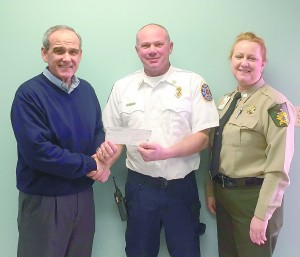 Submitted Crisp County's Interim Fire Chief Jonathan WIndham (center) accepts a $300 check from Lions Club members Mike Browning (left) and Tammera Sears (right)