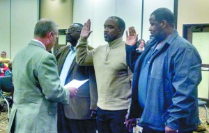 Becky Crissman/Cordele Dispatch Unadilla City Council members (l-r) Chester Thomas, Tyrone Adkinson, and Dexter Whitaker take their oath of office administered by Judge Bowen.