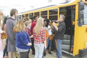 Becky Crissman/Cordele Dispatch Robert Walker welcomes a group of kids to the choice bus and goes over the rules for the program.