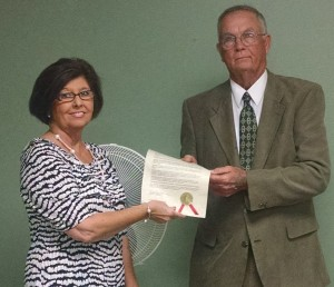 Becky Crissman/Cordele Dispatch Cordele City Commission Chairman Zack Wade presents a proclamation to Cordele-Crisp Chamber of Commerce President Monica Simmons designating Tourism Week in the city.