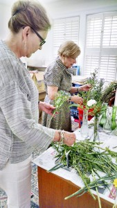 Becky Crissman/Cordele Dispatch Campbell and Perlis fill vases with fresh flowers to take to the residents at Crisp Regional Nursing and Rehab. The trio make the trip to the nursing home every Thursday.