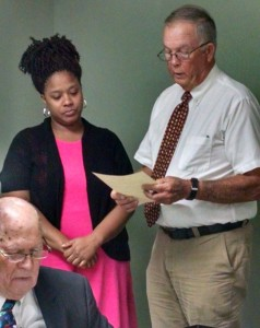 Becky Crissman/Cordele Dispatch Chairman Zack Wade reads and presents a proclamation to Shakeveyia Daniels designating September as Chiari Malformation Month in the city.