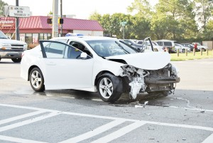 Becky Crissman/Cordele Dispatch Phto shows damage to a car involved in a collision on Tuesday morning at the intersection of 16th Avenue and Greer Street in Cordele